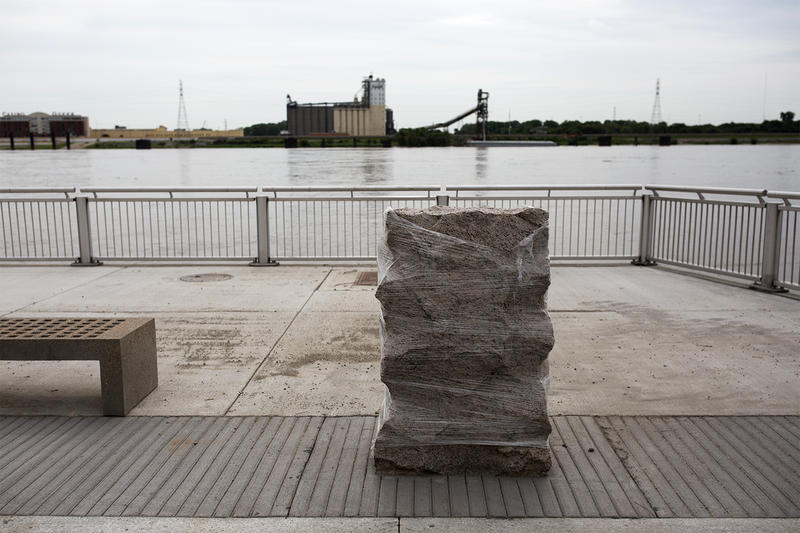 A river-facing plaque sits on a section of the redeveloped riverfront set to open on Thursday.