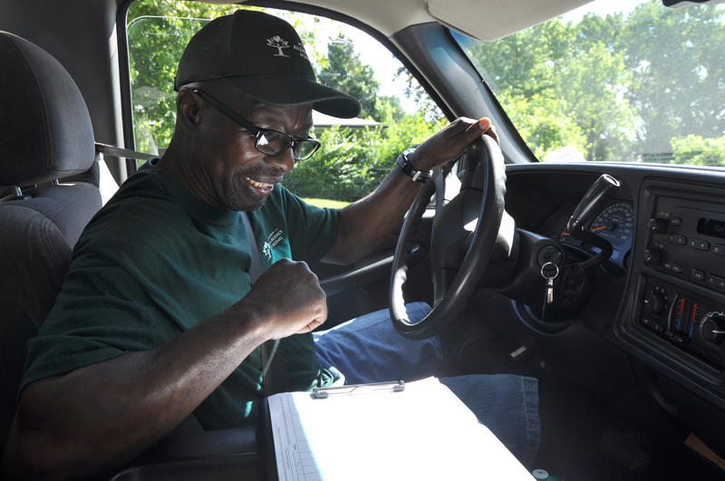 Van Tyler checks a list of names and addresses while delivering meals in Jennings for the Mid-East Area Agency on Aging.
