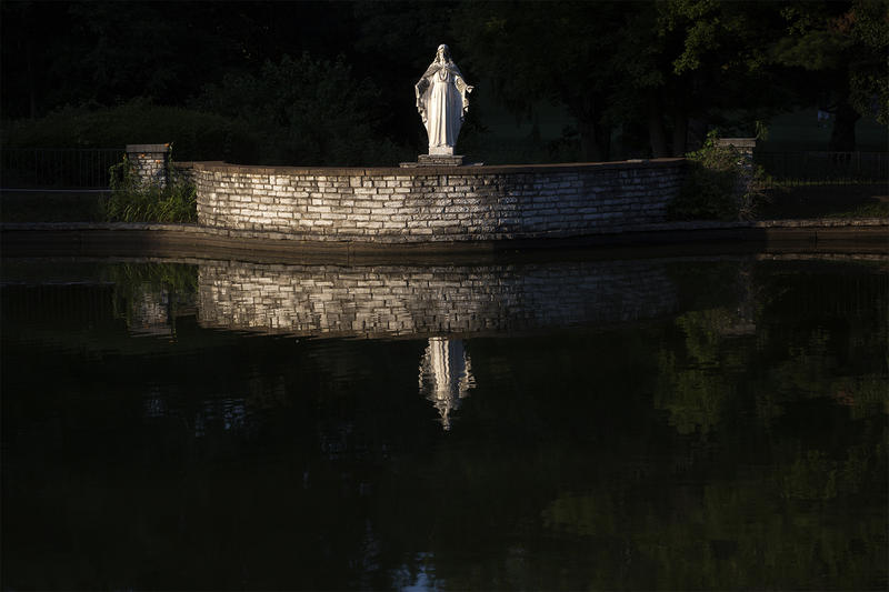 A statue of Jesus and a lake greet visitors to  Lake Charles Park Cemetery on St. Charles Rock Road.