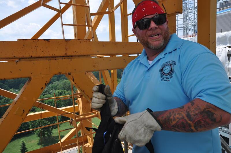 Third-generation crane operator Tim Miller, 41, prepares to climb up a crane helping to build a new Barnes Hospital building.