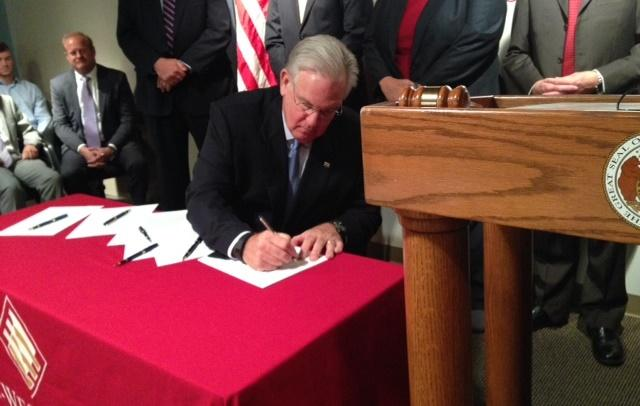 Gov. Jay Nixon signed House Bill 1434 on Wednesday at the East-West Gateway Council of Governments.