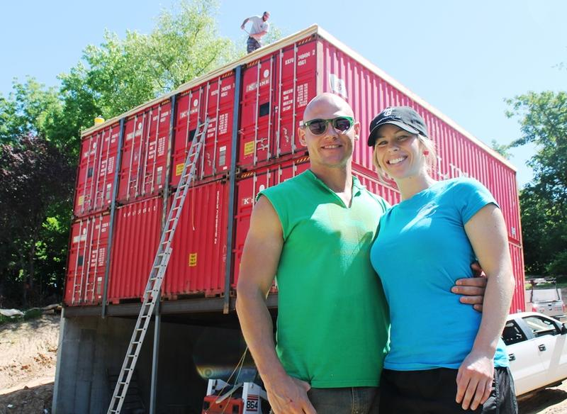 Zack and Brie Smithey in front of their shipping-container home under construction in July 2016