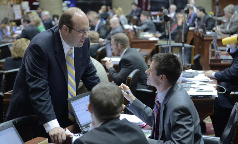 Speaker Pro Tem Jason Smith, R-Salem, speaks with fellow Republican legislators on the final day of the General Assembly's 2013 session. Smith - the GOP nominee in the 8th Congressional District - received a standing ovation then, including from Democrats