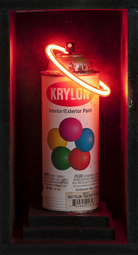 Red neon Krylon can in shadowbox by local artist Nick Miller is estimated to go for between $950 and $1,200.