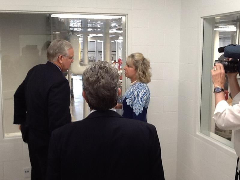 The Office of Administration's  Cathy Brown gives Gov. Jay Nixon a tour of the new ECC & Services Building.  Standing in the foreground, back turned, is Fulton State Hospital CEO Bob Reitz.