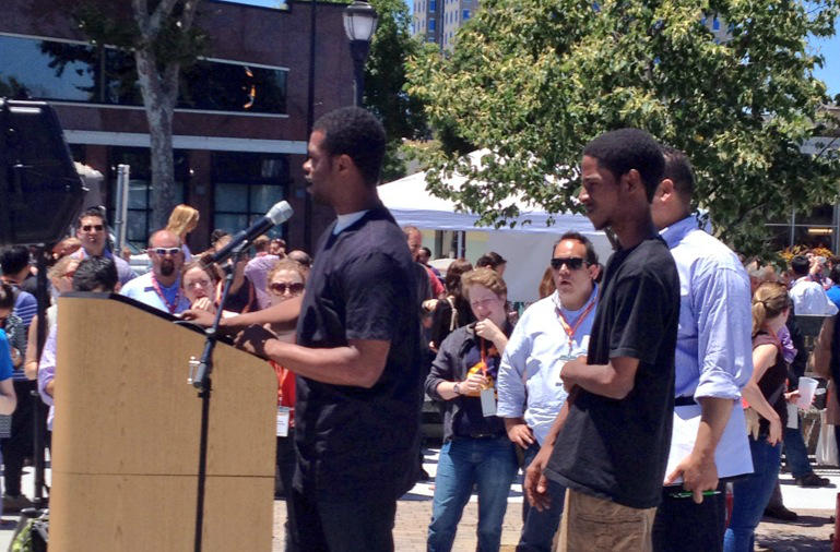Rasheen Aldridge speaks at a California rally.