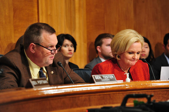 Sens. Jon Tester, D-Mont., and Claire McCaskill, D-Mo., chair a hearing in which problems with background checks were disclosed.
