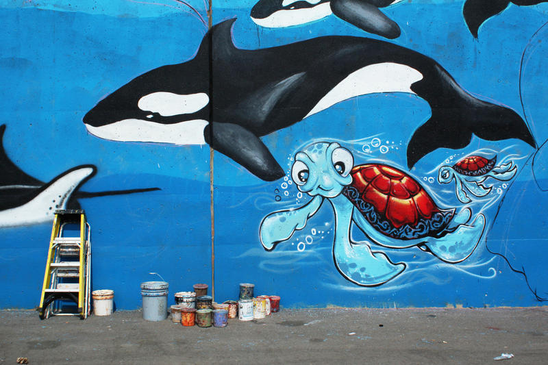'Tails of the Mississippi' detail mural photo blue background with turtle and killer whale