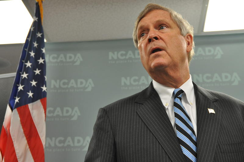 U.S. Secretary of Agriculture, Tom Vilsack, speaks during a visit to NCADA's offices in St. Louis County. He leads a government task force to curb opioid abuse.