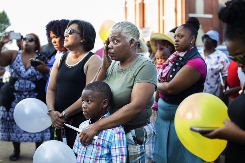 Family, friends and colleagues gathered outside Dunbar Elementary School to remember Jacara Sproaps.
