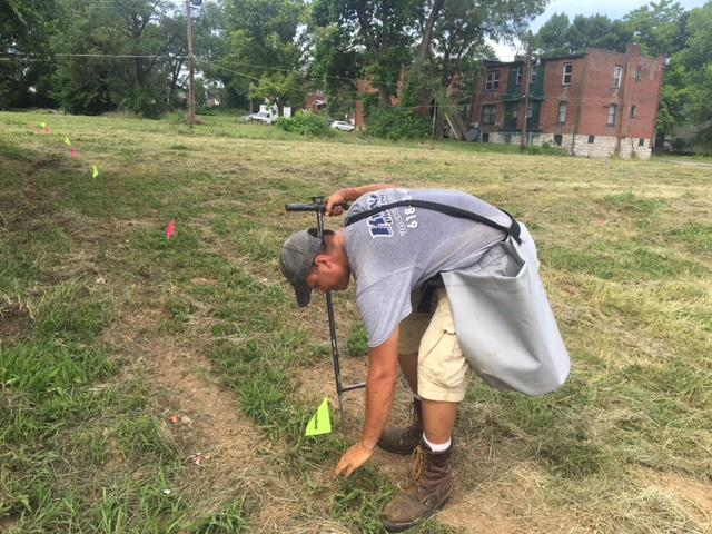 A crew member with Matt's Health Woods & Wildlife plants hybrid poplar trees in the Wells-Goodfellow neighborhood of St. Louis. Fresh Coast Capital is leasing 42 parcels from the city for an urban tree farm. July 13, 2016