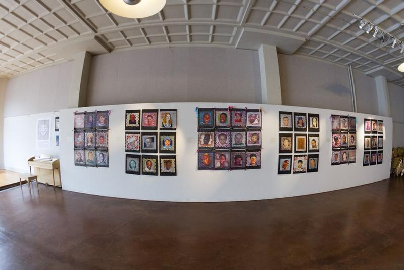 A wide-angle view of the Faces Not Forgotten exhibition at the Jacoby Arts Center.
