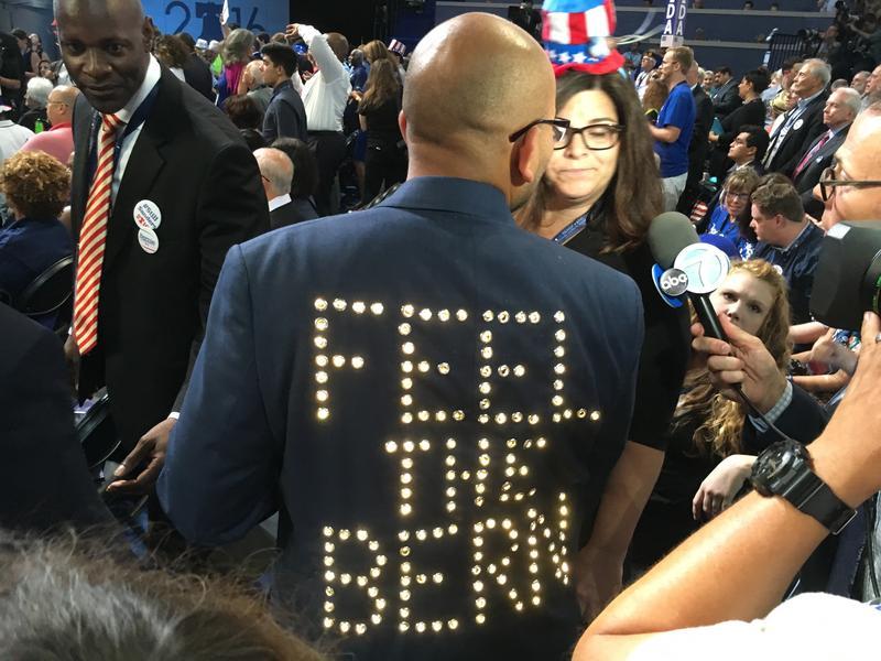 A Bernie Sanders delegate sports a