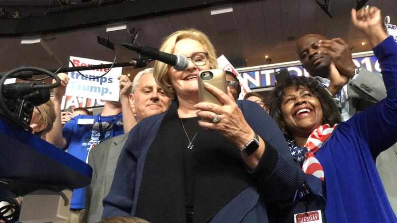 U.S. Sen. Claire McCaskill reads a prepared speech off her smartphone as she casts Missouri's delegate votes at the Democratic National Convention in Philadelphia.