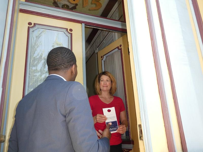 Marty Murray, a candidate for 7th Ward committeeman, talks to Stacy Kistler while knocking doors in the Lafayette Square neighborhood of St. Louis on June 10, 2016.