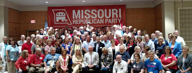 The delegation poses in the room where they heard from speakers during the Republican convention.