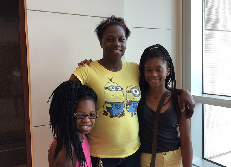 LeDiva Pierce with her daughters Alfreida (left) and Unique. Pierce is one of two charter school parents seeking to intervene as plaintiffs in St. Louis Public School's dispute with the state over funding.