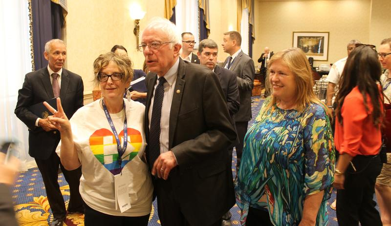 U.S. Sen. Bernie Sanders and his wife Jane pose for a picture with a supporter in Philadelphia. Sanders make a surprise appearance at the Missouri delegation's breakfast on Tuesday.