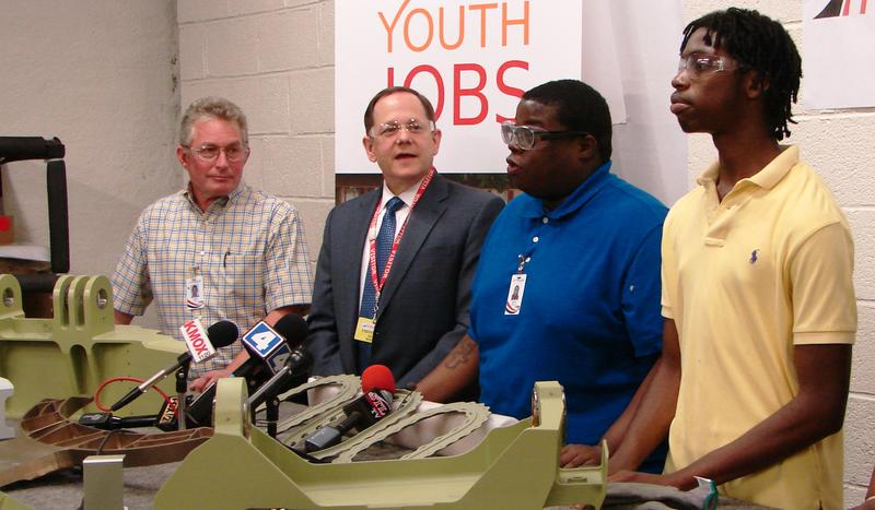 Jarvis Jefferson-Bey (in blue) talks about his summer position at HM Dunn Aerospace. He's joined by the company's general manager, Chris Ross (far left), fellow particpant Kalon Garrison (in yellow), and Mayor Francis Slay.