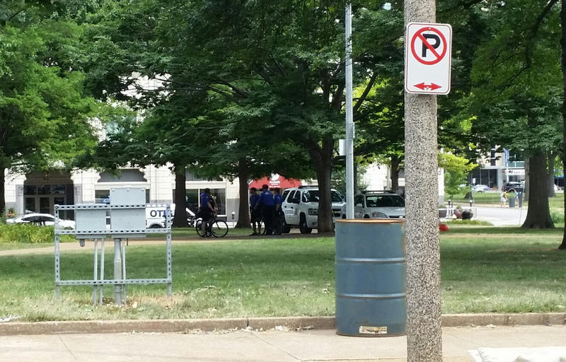 St. Louis city police convene June 28, 2016 at the park across the street from the St. Louis Public Library headquarters on Olive Street downtown. People experiencing homelessness often can be found at the park.
