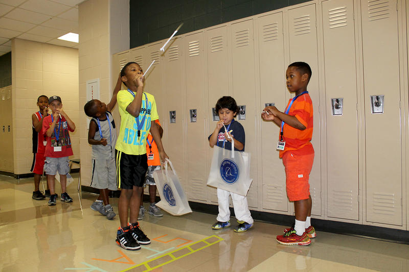 Third-grader Michael Scott launches his straw rocket at Boeing's free science and technology camp Saturday, July 16, 2016 at McClure South-Berkley High School.