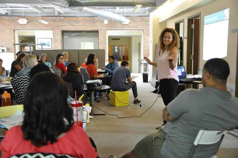 During a training for new volunteers, Provident clinician Adrianne Martin (standing) leads an exercise in active listening.