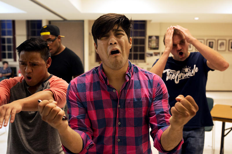 "Kelvin Urday, center, rehearses ""21 Chump Street"" with, from left to right, Kevin Corpuz, Omega Jones and Phil Leveling."
