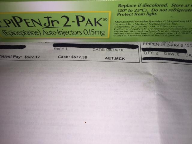 Maureen Walkenbach photographed the receipt after filling her son's prescription for EpiPen Jr. Because her family's health insurance has a high deductible, she must pay nearly the full price.