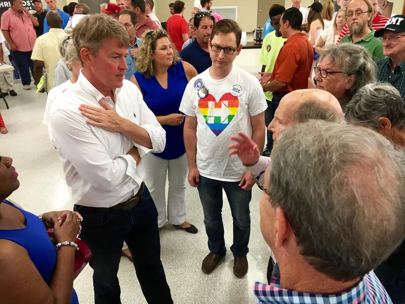 Democratic gubernatorial hopeful Chris Koster talks with supporters on Saturday in St. Louis. Koster says he's opposed to school vouchers, but is amenable to charter schools.