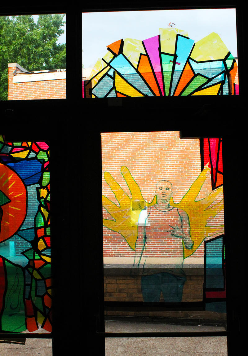 Window art depicting Michael Brown Jr. decorates the doors of Greater St. Mark's.