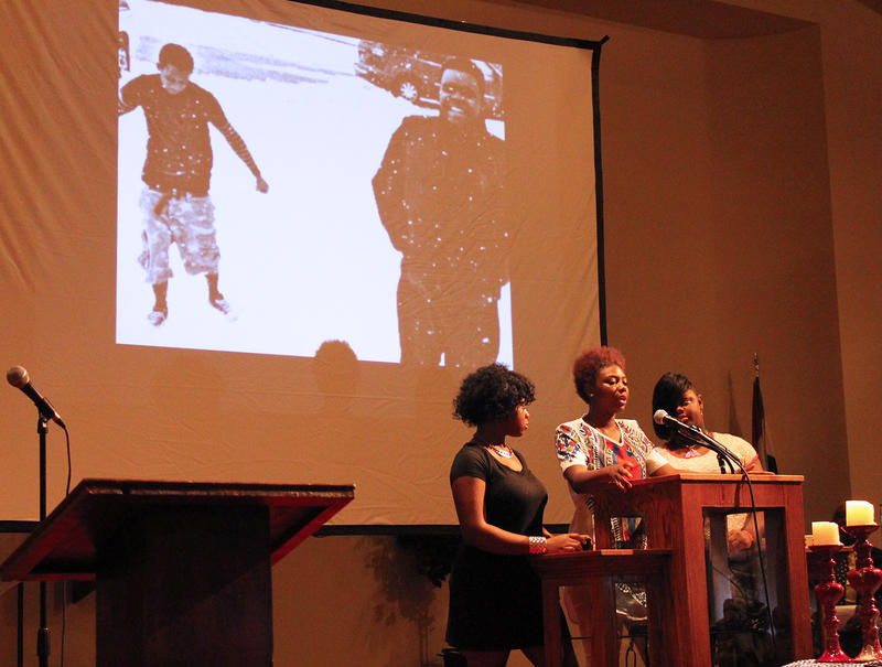 Trinity, Trinita and Triniya Walker address the crowd after airing a film they created in memory of their brother, Michael Brown Jr.