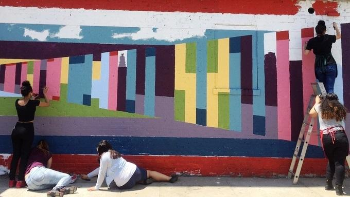 """Visualize Pi Perspective"" is a 2015 Brooklyn mural by Ellie Balk, painted with the help of local students. Pi is represented as a color coded bar graph drawn in one-point perspective. See finished mural in story, below."