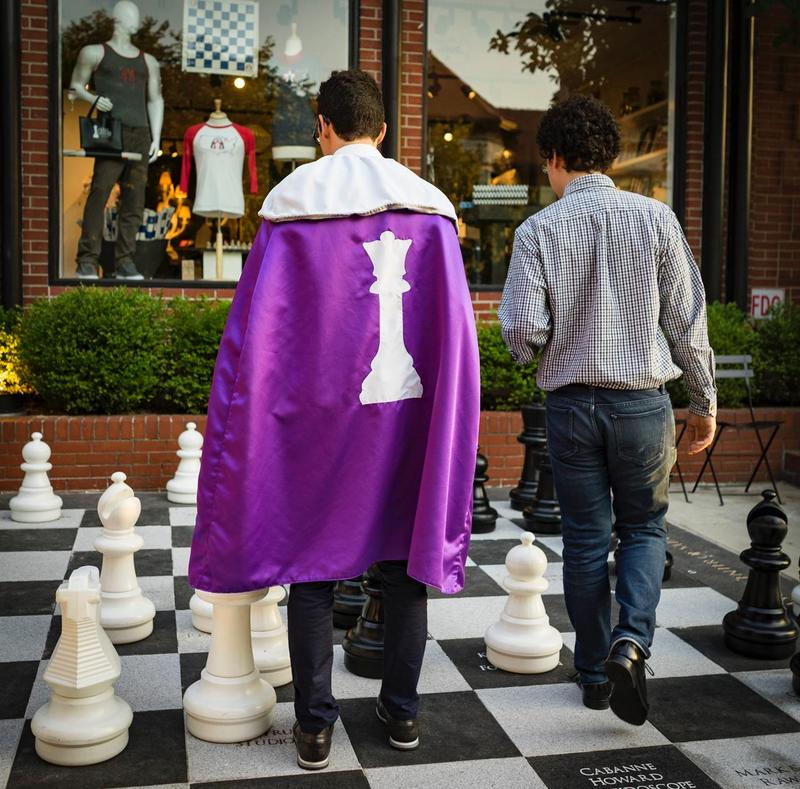 Alejandro Ramriez (the author) and Fabiano Caruano play on the giant chess board outside the World Chess Hall of Fame.