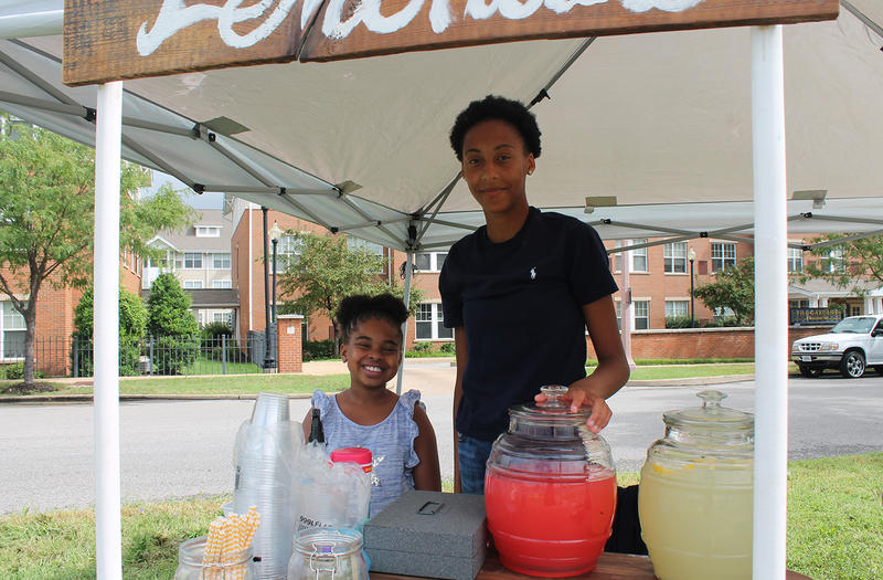 Janaya Heard, 9, and Armani Williams, 15, pose for a portrait inside their lemonade stand Aug. 13, 2016. Janaya likes the regular lemonade; Armani suggested trying the watermelon lemonade.