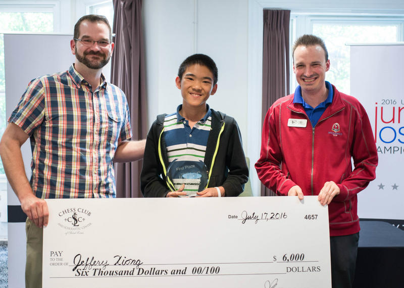 Tony Rich, executive director of the Chess Club, presents a check to Jeffery Xiong after he won the 2016 U.S. Junior Closed tournament in St, Louis. At right is Mike Kummer, deputy arbiter.