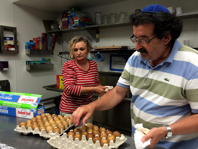 Miryam Tauber and Eli Tauber prepare Sephardic eggs in preparation for Miryam's cooking class on Aug. 19, 2016. The eggs are boiled at a low temperature for hours with onion skins.