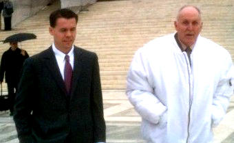 Vernon Hugh Bowman (in white jacket) with attorney Mark P. Walters outside the Supreme Court in February when his case was argued.