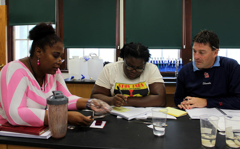 SLPS science teachers Ninfa Matiase, LaJuana Stidmon and Jeremy Resmann practice an experiment Aug. 3, 2016 during training provided by the National Math and Science Initiative.