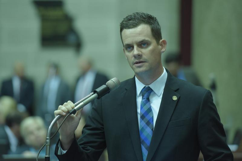 State Rep. Justin Alferman speaks at the microphone during Wednesday's veto session. Lawmakers overrode Gov. Jay Nixon's veto of Alferman's photo idenitifcation bill.