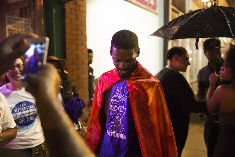 Bruce Franks Jr. poses with a cape given to him by a supporter.