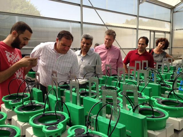 A plantDitech employee (left) shows the product to Sam Fiorello of the Danforth Center;  Vijay Chauhan and Donn Rubin, both of BioSTL. On the right are plantDitech co-founders Menachem and Keren Moshelion.