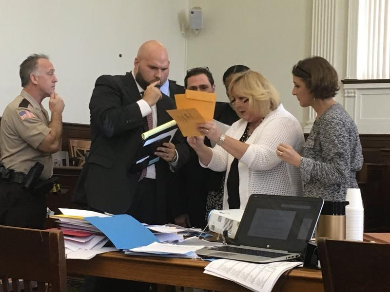Attorneys for Bruce Franks, Penny Hubbard, and employees with the St. Louis Board of Election Commissioners examine absentee ballot envelopes during a court hearing on Sept. 1, 2016.