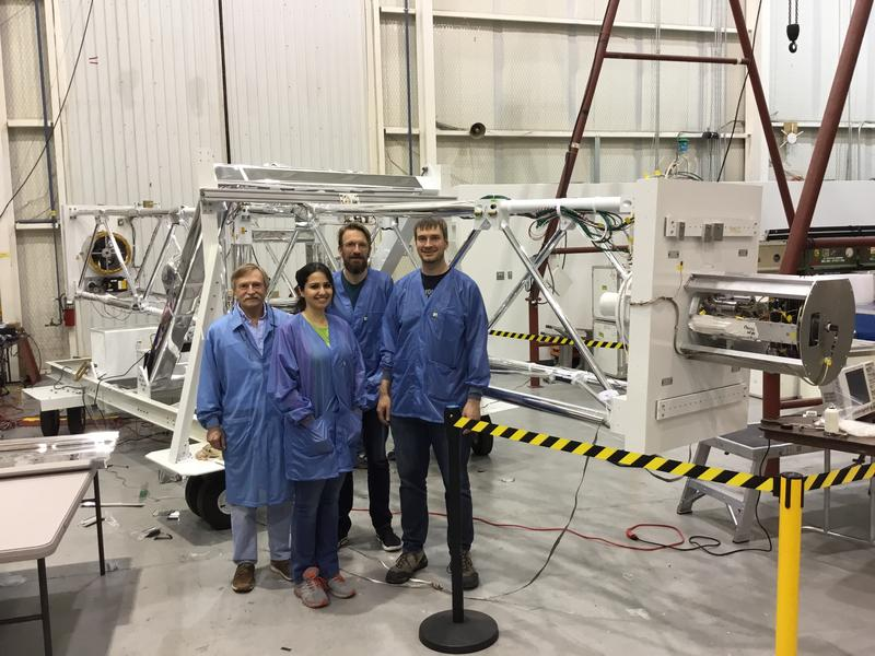 Washington University team (from left to right): electrical engineer Paul Dowkontt, graduate student Banafsheh Beheshtipour, and professors Krawczynski and Kislat) in the Fort Sumner NASA station in front of the X-Ray telescope.