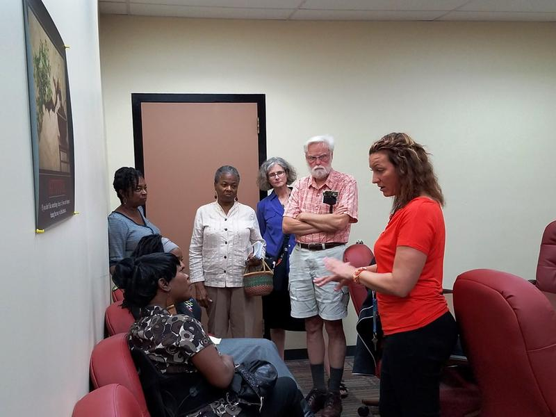 Clara Norise (seated) speaks to Nicolle Barton, the executive director of the Civilian Oversight Board, after the board's meeting on Sept. 19, 2016. Norise was the first person to file a complaint with the board.