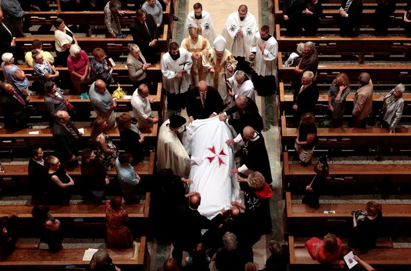 The casket of Phyllis Schlafly is escorted down the aisle of the Cathedral Basilicia of St. Louis following a funeral Mass on Sept. 10, 2016.