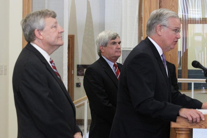 Attorneys Erwin Switzer (back left) and Al Johnson (back right) listen to Gov. Jay Nixon on Sept. 6 as he introduces them as the chair and secretary of the St. Louis Board of Election Commissioners.
