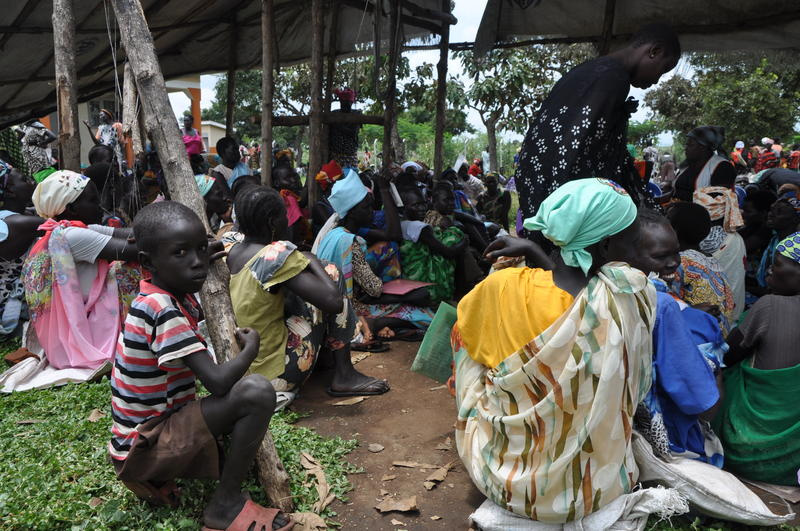 South Sudanese refugees wait to receive food rations in northen Uganda.