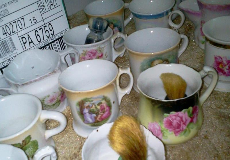 An assortment of shaving mugs