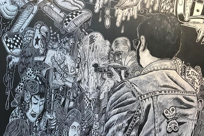 "10-27-2016: This detail from Edo Rosenblith's mural, ""Supper Club,"" in the Techartista co-working building. shows the artist within his work."