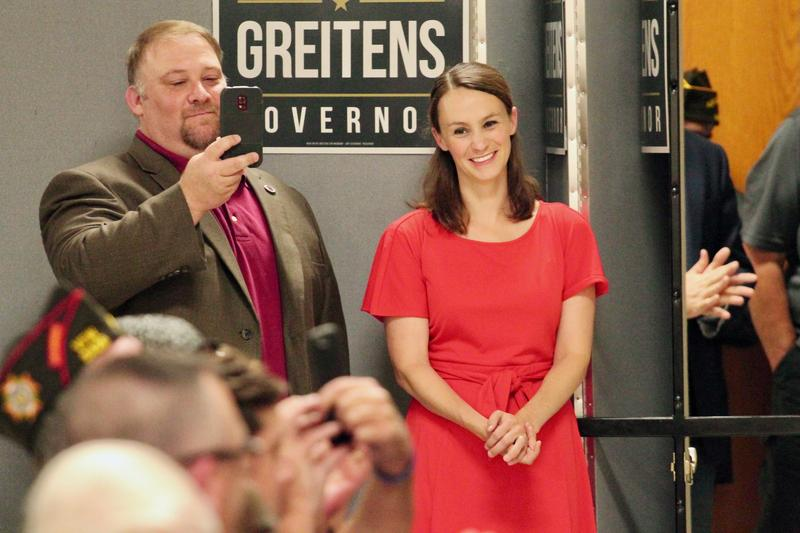 Sheena Greitens watches her husband Eric Greitens make a speech in Overland. Sheena Greitens, who has a Ph.D. from Harvard, teaches at the University of Missouri-Columbia and is a senior fellow at the Brookings Institution's Center for East Asia